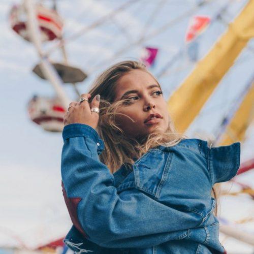 woman-in-denim-jacket-at-fair