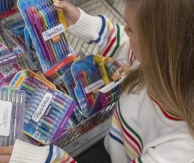 Finley looking at pens
